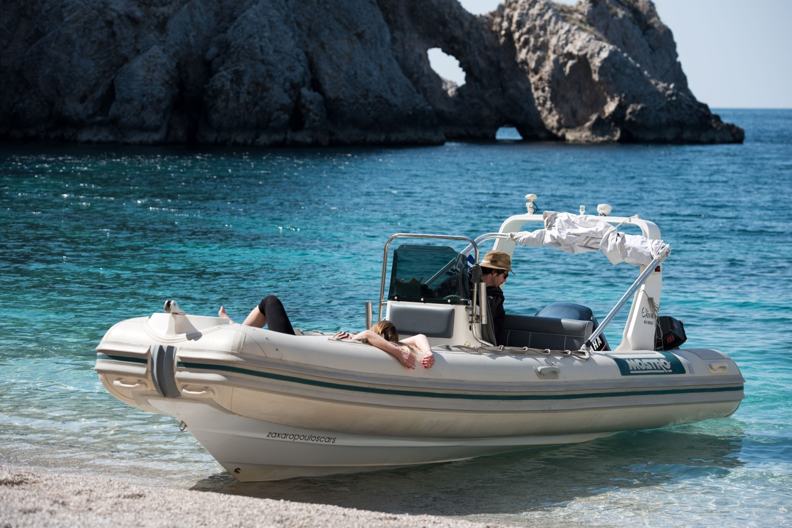 Couple relaxing during a boat trip arranged by Lido Blue